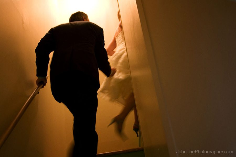Greg and Kristin head up the stairs following their wedding in Olympia, Washington